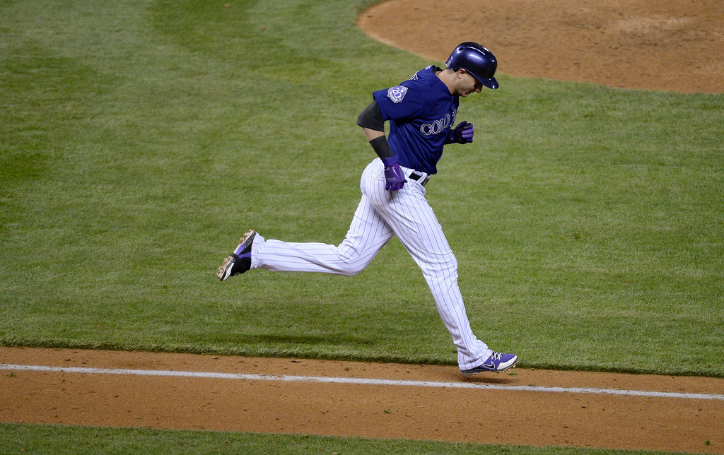 . DENVER, CO. - MAY 20: Troy Tulowitzki (2) of the Colorado Rockies runs down the line with his head down after grounding out to Didi Gregorius (1) of the Arizona Diamondbacks to end the game May 20, 2013 at Coors Field. Arizona defeated Colorado 5-1 in the first of a three game series. (Photo By John Leyba/The Denver Post)