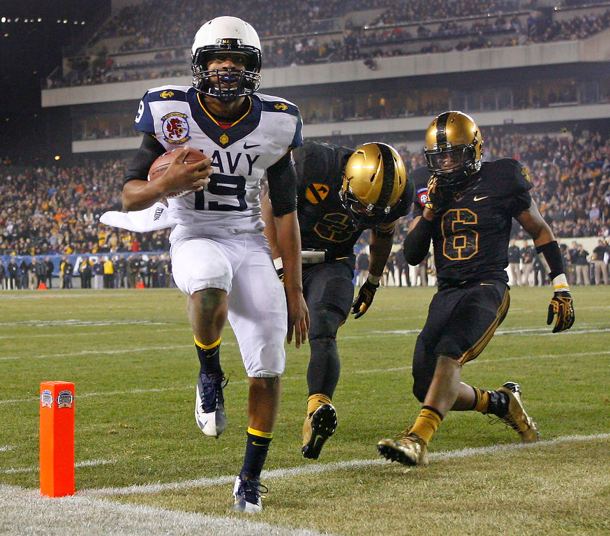 . Keenan Reynolds #19 of the Navy Midshipmen scores the game-winning touchdown during a game against the Army Black Knights on December 8, 2012, at Lincoln Financial Field in Philadelphia, Pennsylvania. The Navy won 17-13. (Photo by Hunter Martin/Getty Images)
