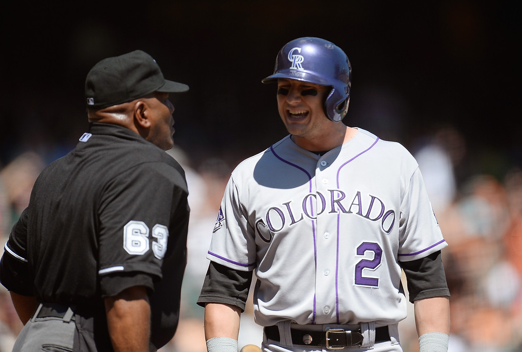 . SAN FRANCISCO, CA - APRIL 10: Troy Tulowitzki #2 of the Colorado Rockies argues with home plate umpire Laz Diaz #63 over a called strike three against the San Francisco Giants in the first inning at AT&T Park on April 10, 2013 in San Francisco, California. (Photo by Thearon W. Henderson/Getty Images)