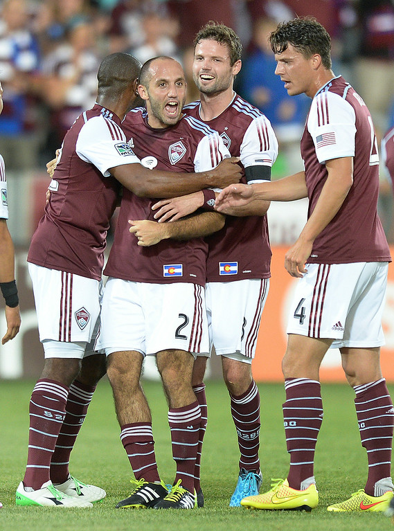 . Teammates celebrated Nick LaBrocca\'s (2) goal with him in the first half as the Colorado Rapids hosted Chivas USA at Dick\'s Sporting Goods Park Friday night, July 25, 2014. Photo by Karl Gehring/The Denver Post