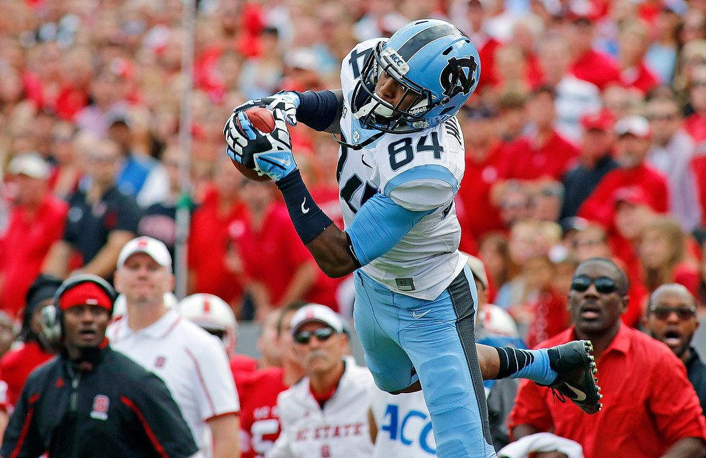. North Carolina\'s Bug Howard (84) hauls in a pass from Marquise Williams during the second half of an NCAA college football game against North Carolina State in Raleigh, N.C., Saturday, Nov. 2, 2013. North Carolina won 27-19. (AP Photo/Karl B DeBlaker)
