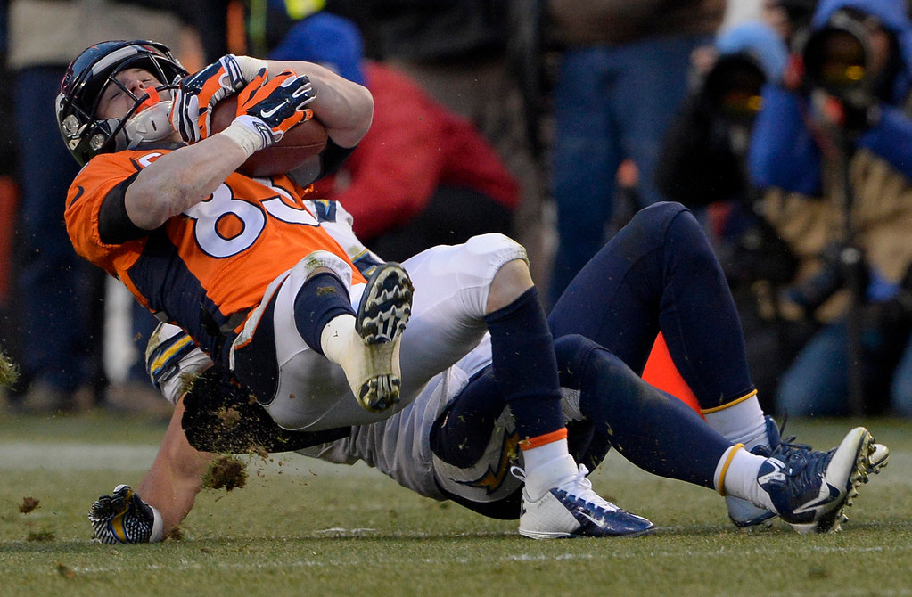 . Denver Broncos wide receiver Wes Welker (83) gets taken down during the third quarter. The Denver Broncos vs. The San Diego Chargers in an AFC Divisional Playoff game at Sports Authority Field at Mile High in Denver on January 12, 2014. (Photo by Joe Amon/The Denver Post)