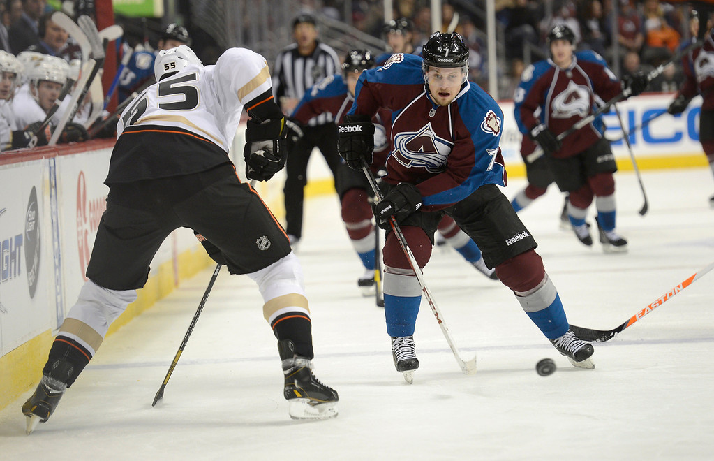 . DENVER, CO. - FEBRUARY 06: John Mitchell (7) of the Colorado Avalanche skate the puck up ice as Bryan Allen (55) of the Anaheim Ducks defends on the play February 6, 2013 at Pepsi Center.  The Colorado Avalanche take on the Anaheim Ducks during NHL action. (Photo By John Leyba / The Denver Post)