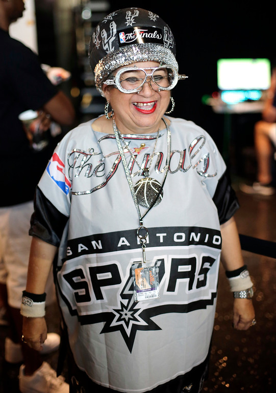 . San Antonio Spurs fan Savia Lauriano shows her team support before Game 4 of the NBA Finals basketball series against the Miami Heat, Thursday, June 13, 2013, in San Antonio. (AP Photo/Eric Gay)