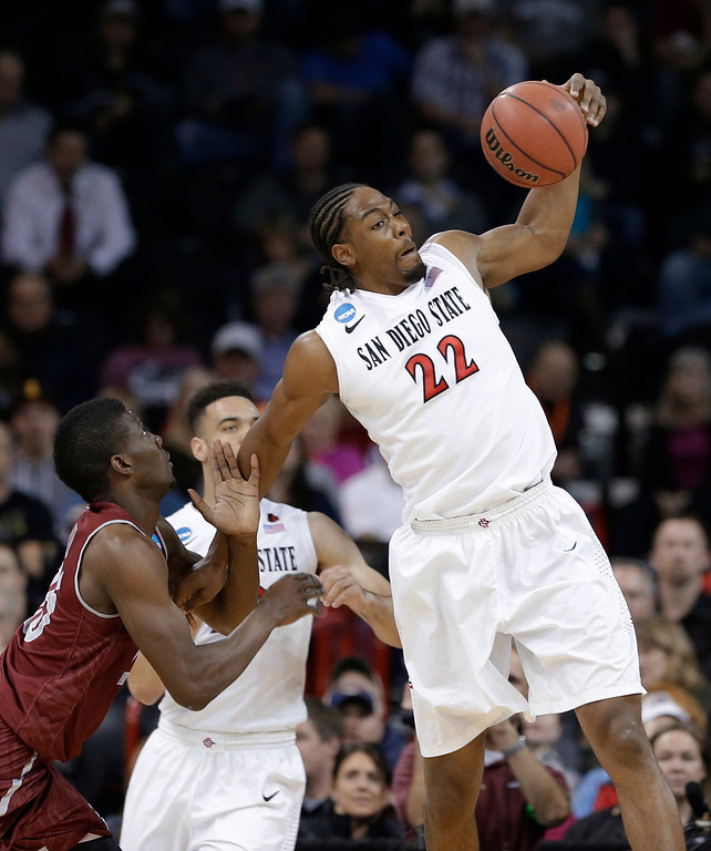 . San Diego State\'s Josh Davis (22) reaches for a loose ball against New Mexico State in the first half during a second-round game of the NCAA men\'s college basketball tournament in Spokane, Wash., Thursday, March 20, 2014. (AP Photo/Elaine Thompson)