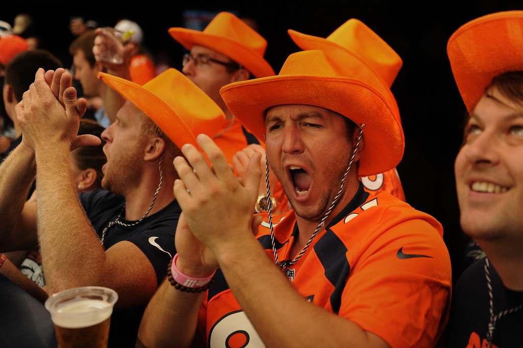 . ARLINGTON, TX. - October 06: Matt Elio of Denver cheering as the Broncos come out to warm up before their game vs the Dallas Cowboys in game 5 at AT&T Stadium October 06, 2013 Arlington, Texas. (Photo By Joe Amon/The Denver Post)