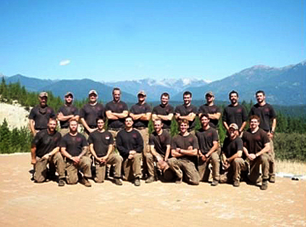 ". This undated picture provided by KPHO-TV/CBS-5-AZ.COM shows the Prescott Granite Mountain Hotshot crew of Prescott, Arizona. 19 hotshot firefighters were killed Sunday battling a fast-moving wildfire in Arizona, in one of the worst incidents of its kind in US history, as flames ravaged homes and forced the evacuation of two towns. The firefighters died while racing to contain the Yarnell Hill wildfire about 85 miles (135 kilometers) north of Phoenix, in what Arizona governor Jan Brewer called ""as dark a day as I can remember.\""   (KPHO-TV/CBS-5-AZ.COM/AFP/Getty Images)"