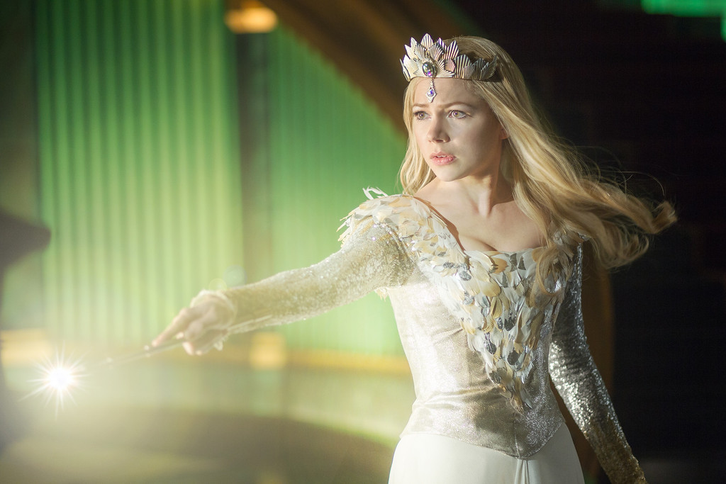 """. \""""OZ: THE GREAT AND POWERFUL\"""" Michelle Williams center Ph: Merie Weismiller Wallace, SMPSP ©Disney Enterprises, Inc. All Rights Reserved."""