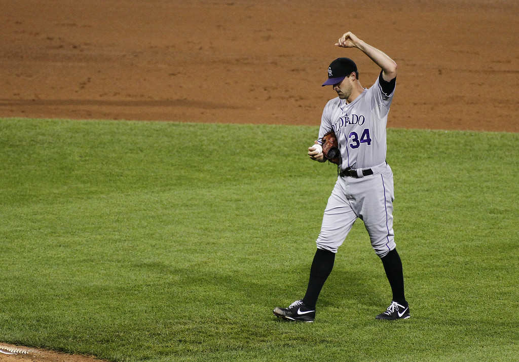 . PITTSBURGH, PA - JULY 18:  Matt Belisle #34 of the Colorado Rockies reacts after giving up a RBI double in the eighth inning against the Pittsburgh Pirates during the game at PNC Park July 18, 2014 in Pittsburgh, Pennsylvania.  (Photo by Justin K. Aller/Getty Images)