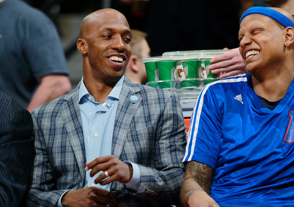 . Injured Detroit Pistons guard Chauncey Billups, left, jokes with forward Charlie Villanueva while looking on from the bench as the Pistons face the Denver Nuggets in the first quarter of an NBA basketball game in Denver on Wednesday, March 19, 2014. Billups is a Denver native who was a standout in high school and at the University of Colorado before heading to the NBA. (AP Photo/David Zalubowski)