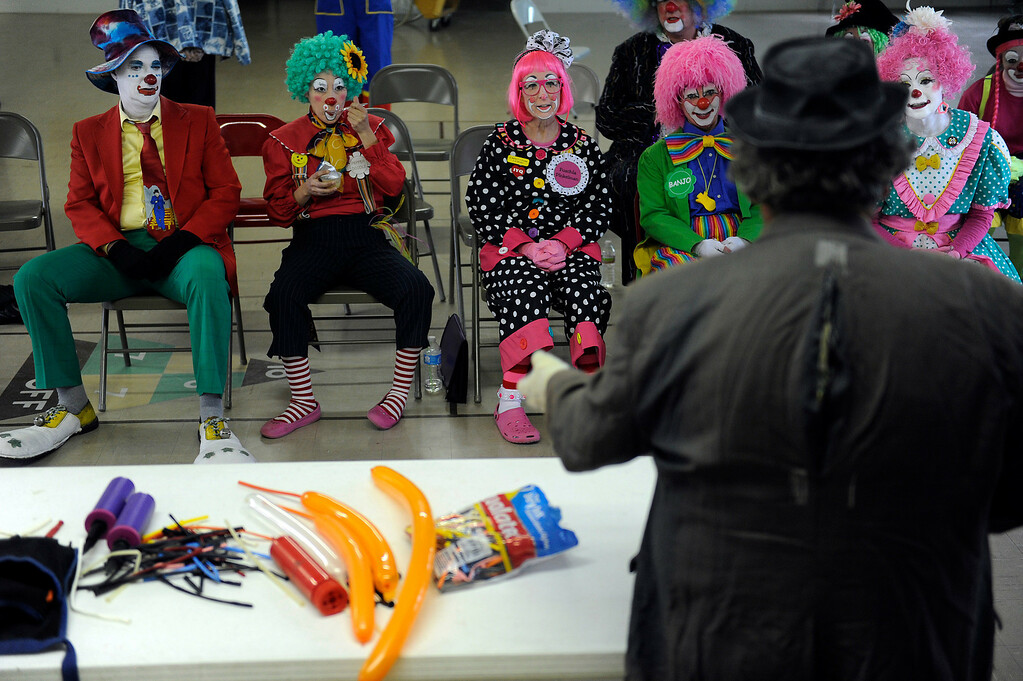 . Students and alumni watch as Retread, aka Bernie Lopez, demonstrates how to make balloon animals during Clown Class at First Presbyterian Church in Englewood on Sunday, March 3, 2013. The Colorado Clowns presented the 10-week series of classes that taught participants how to apply make up, character development, skits, parades and the history of clowning. Seth A. McConnell, YourHub