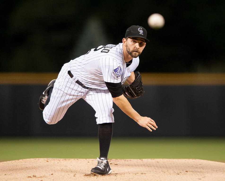 . Tyler Chatwood #32 of the Colorado Rockies pitches in the first inning of a game against the St. Louis Cardinals at Coors Field on September 18, 2013 in Denver, Colorado. (Photo by Dustin Bradford/Getty Images)