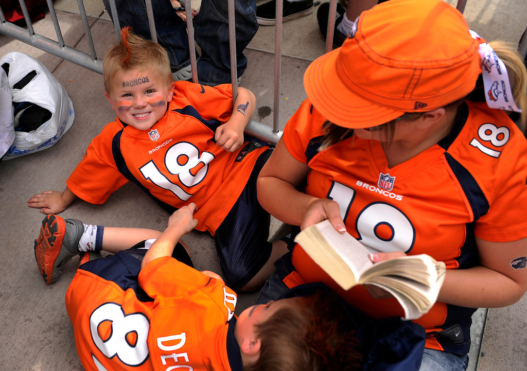 . DENVER, CO. - AUGUST 03: Peyton Seay, left, waited with his brother Hayden and his mother Sarah outside the stadium Saturday. His family drove 13 hours from Minot, North Dakota to watch a couple of practices.  Peyton was named for Broncos quarterback Peyton Manning. Denver Broncos fans lined up outside Sports Authority Field Saturday afternoon, August 3, 2013 before gates opened to watch practice.  Photo By Karl Gehring/The Denver Post