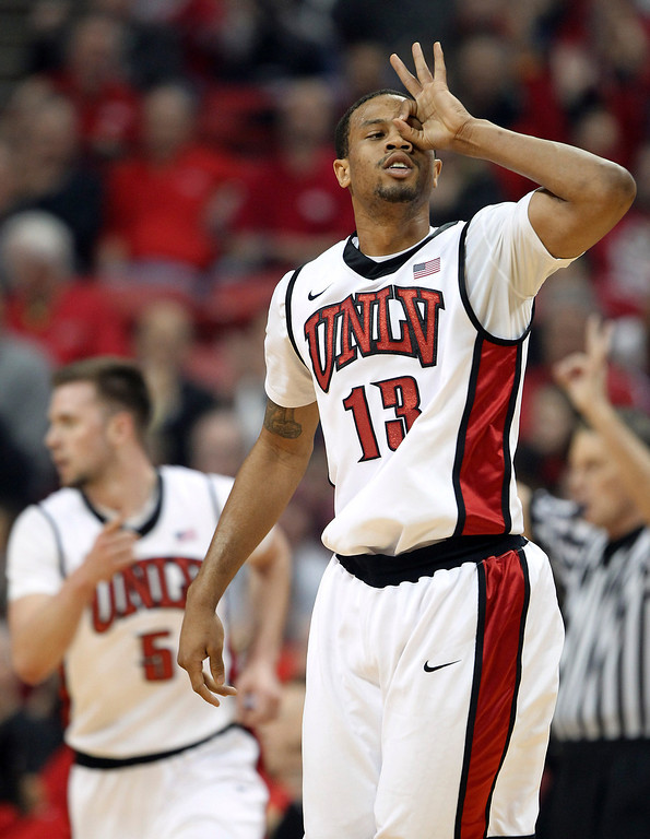 . UNLV\'s Bryce Dejean-Jones gestures after sinking a 3-point shot during the first half of an NCAA college basketball game against Colorado State on Wednesday, Feb. 20, 2013, in Las Vegas. (AP Photo/Isaac Brekken)