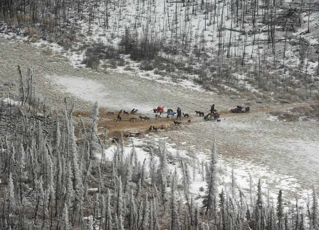 . Rick Casillo, Charley Bejna and Jake Berkowitz are parked in the middle of the Farewell Burn during the  Iditarod Trail Sled Dog Race on Tuesday, March 4, 201. Berkowitzís sled is busted beyond repair and he scratched. (AP Photo/The Anchorage Daily News, Bob Hallinen)