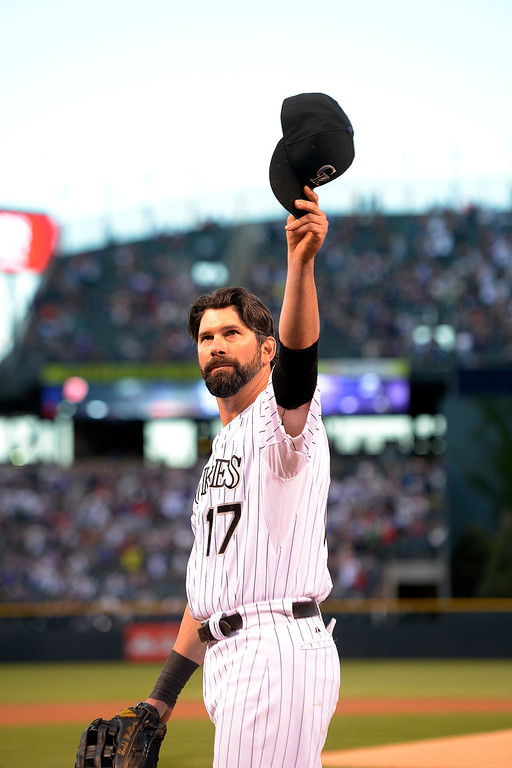 . Todd Helton tips his cap the crowd before the start of action in Denver. The Colorado Rockies hosted the Boston Red Sox and said farewell to longtime first baseman Todd Helton, who recently announced his retirement following this season. (Photo by John Leyba/The Denver Post)