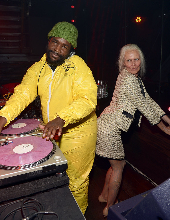 . Questlove (L) and Heidi Klum attend Shutterfly Presents Heidi Klum\'s 14th Annual Halloween Party sponsored by SVEDKA Vodka and smartwater at Marquee on October 31, 2013 in New York City.  (Photo by Mike Coppola/Getty Images for Heidi Klum)