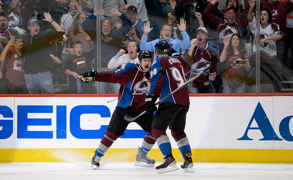 . DENVER, CO - APRIL 26: Colorado Avalanche left wing Cody McLeod (55) celebrates after scoring the Avalanche first goal of the game during the second period of action. Colorado Avalanche center Ryan O\'Reilly (90) assisted on the goal.  The Colorado Avalanche hosted the Minnesota Wild in the fifth round of the Stanley Cup Playoffs at the Pepsi Center in Denver, Colorado on Saturday, April 26, 2014. (Photo by John Leyba/The Denver Post)