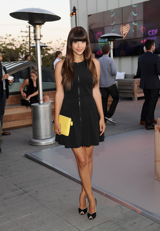 . Actress Hannah Simone carrying Coach, attends Coach\'s 3rd Annual Evening of Cocktails and Shopping to Benefit the Children\'s Defense Fund hosted by Katie McGrath, J.J. Abrams and Bryan Burk at Bad Robot on April 10, 2013 in Santa Monica, California.  (Photo by Stefanie Keenan/Getty Images for Coach)
