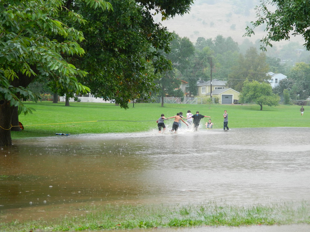 . Kids in North Boulder Park enjoy a surf slingshot in the flood. Photo by Jae Beaubier
