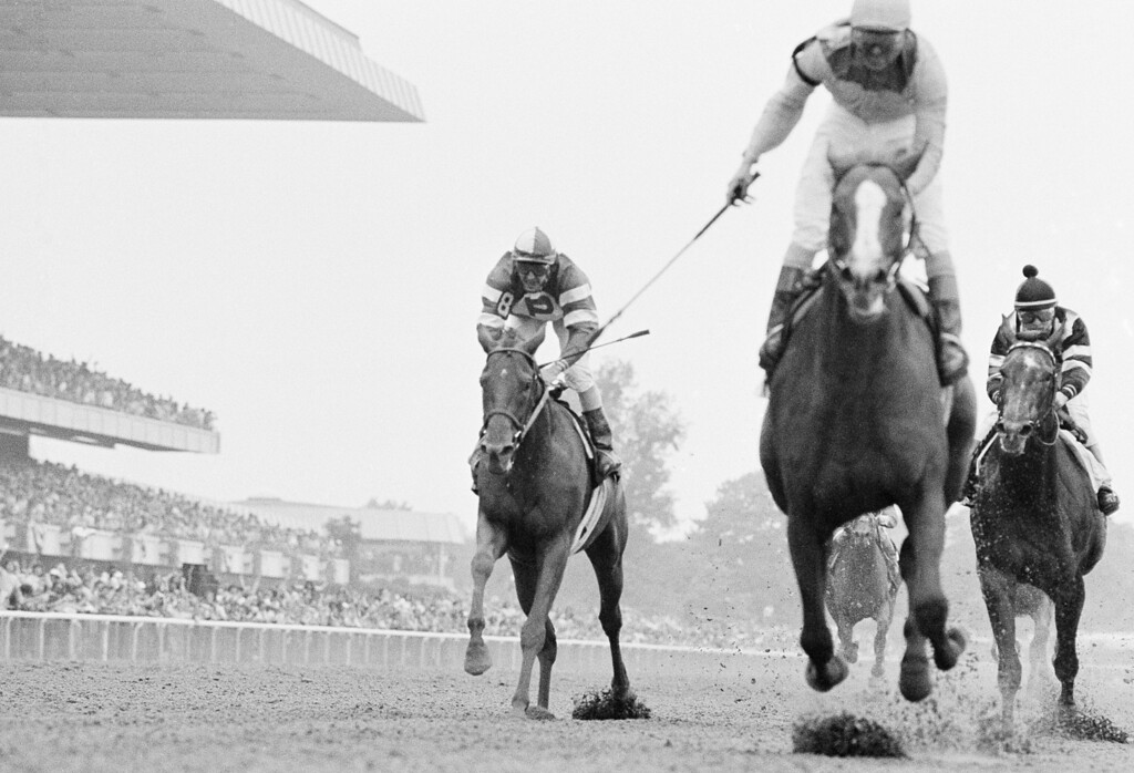 . Coastal,  center, with Ruben Hernandez up, beats Kentucky Derby and Prekness winner Spectacular Bid, right, and Golden Act to win Belmont Stakes on Saturday, June 9, 1979 in Belmont Park., N.Y.    Ronnie Franklin is on Spectacular Bid and Sandy Hawley is on Golden Act. (AP Photo)