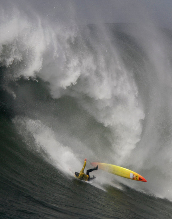 """. Darryl \""""Flea\"""" Virostko wipes out in heat 5 during the 2010 Maverick\'s Big Wave Surf Contest at the Mavericks surf break off Half Moon Bay on Saturday,  Feb. 13, 2010.  Surfers from around the world, including three-time winner Darryl \""""Flea\"""" Virostko of Santa Cruz, competed for $150,000 in total prize money, with a $50,000 pay day going to the winner.   (Photo by Patrick Tehan/Mercury News)"""