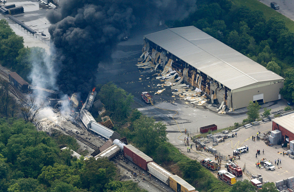 . A fire burns at the site of a CSX freight train derailment, Tuesday, May 28, 2013, in White Marsh, Md., where fire officials say the train crashed into a trash truck, causing an explosion that rattled homes at least a half-mile away and collapsed nearby buildings. (AP Photo/Patrick Semansky)