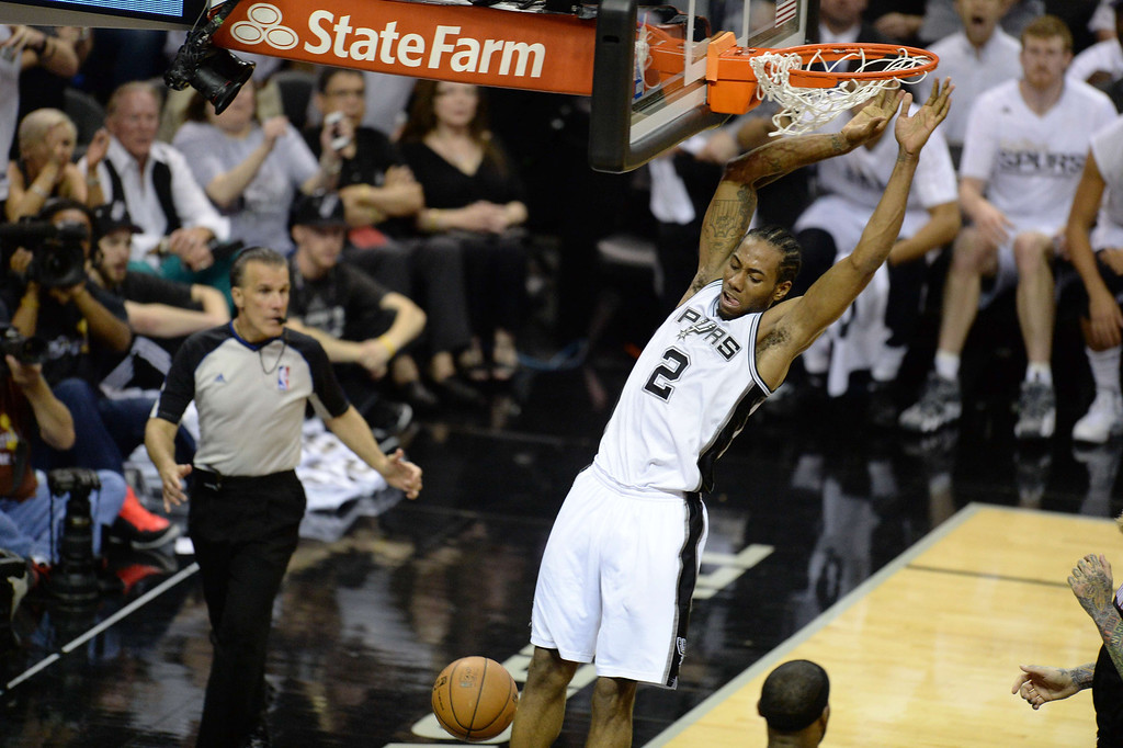 . Kawhi Leonard of the San Antonio Spurs dunks the ball against the Miami Heat during Game 5 of the NBA Finals on June15, 2014 at the AT&T Center in San Antonio,Texas.   ROBYN BECK/AFP/Getty Images