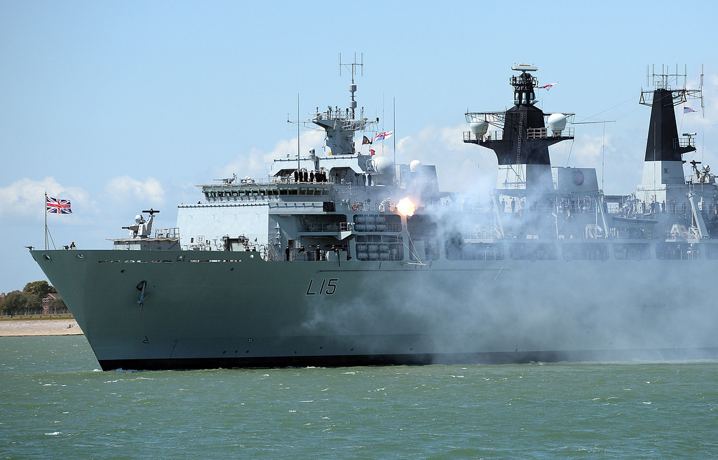. British naval vessel HMS Bulwark fires a gun salute during a beach landing demonstration during D-Day commemorations in Portsmouth in southern England on June 5, 2014. Several hundred surviving veterans of the 1944 D-Day landings are commemorating the 70th anniversary of the mission on both sides of the English channel.  AFP PHOTO / CARL COURT/AFP/Getty Images