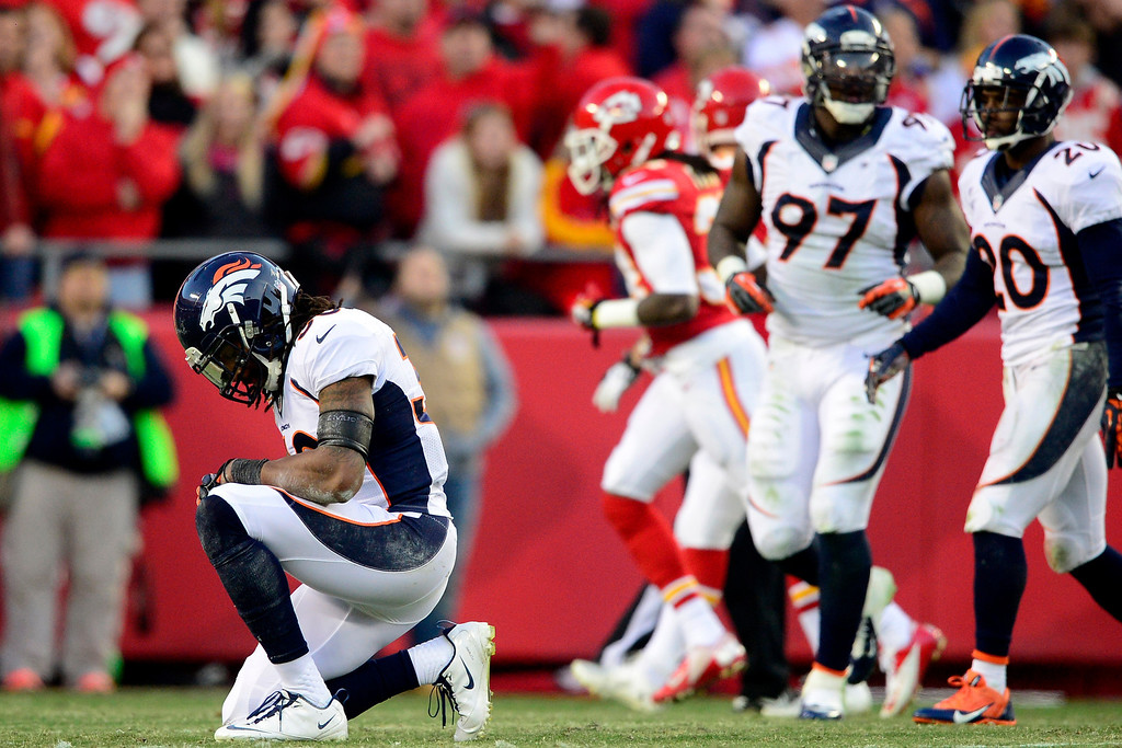 . David Bruton (30) of the Denver Broncos kneels on the grass after being injured against the Kansas City Chiefs during the first half of the Broncos\' 35-28 win at Arrowhead Stadium.   (Photo by AAron Ontiveroz/The Denver Post)