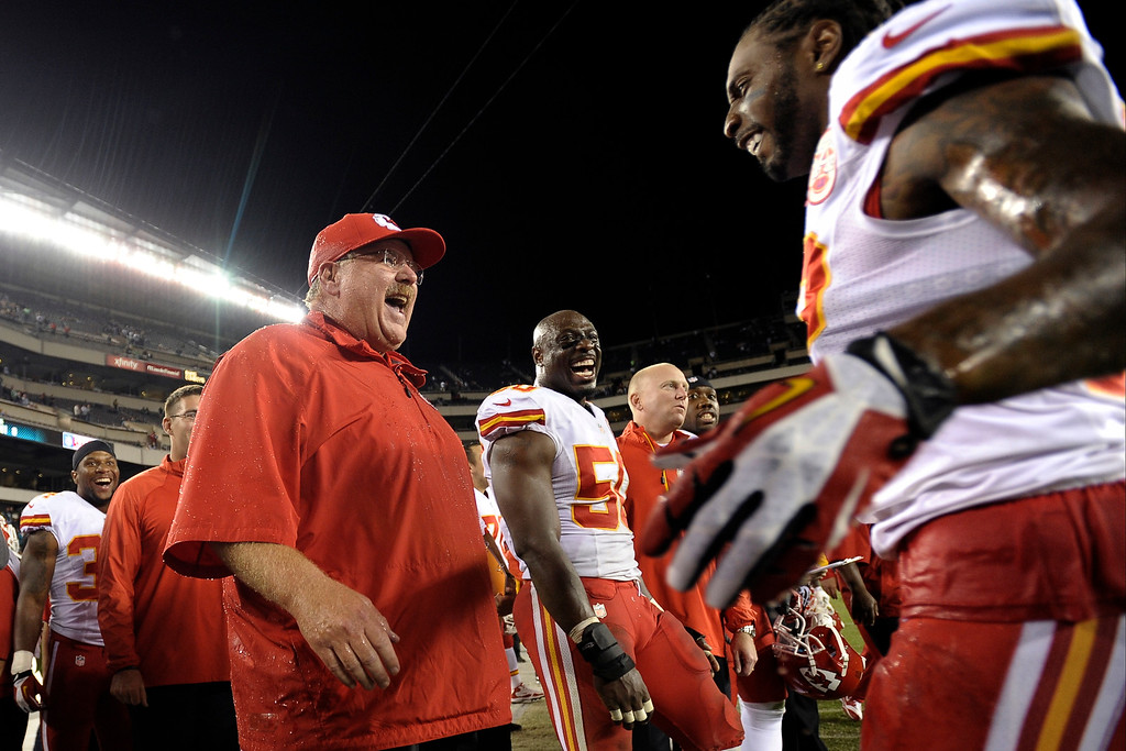. Kansas City Chiefs coach Andy Reid reacts after being doused in the final minutes of the Chiefs\' NFL football game against the Philadelphia Eagles, Thursday, Sept. 19, 2013, in Philadelphia. Kansas City won 26-16. (AP Photo/Michael Perez)