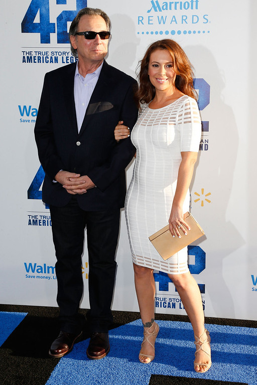 . Actress Alyssa Milano (R) and her father, Thomas M. Milano, attend the premiere of Warner Bros. Pictures\' And Legendary Pictures\' \'42\' at TCL Chinese Theatre on April 9, 2013 in Hollywood, California.  (Photo by Imeh Akpanudosen/Getty Images)
