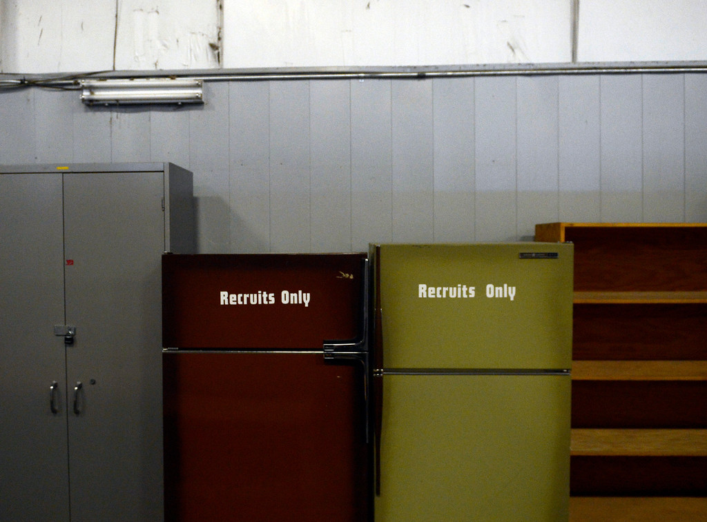 . Two refrigerators in a back room are marked for recruits to use for their lunches during the 27 weeks of academy training, April 29, 2013. (Photo By RJ Sangosti/The Denver Post)