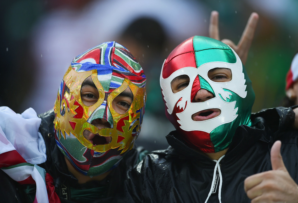 . Mexico fans show their support prior to the 2014 FIFA World Cup Brazil Group A match between Mexico and Cameroon at Estadio das Dunas on June 13, 2014 in Natal, Brazil.  (Photo by Matthias Hangst/Getty Images)