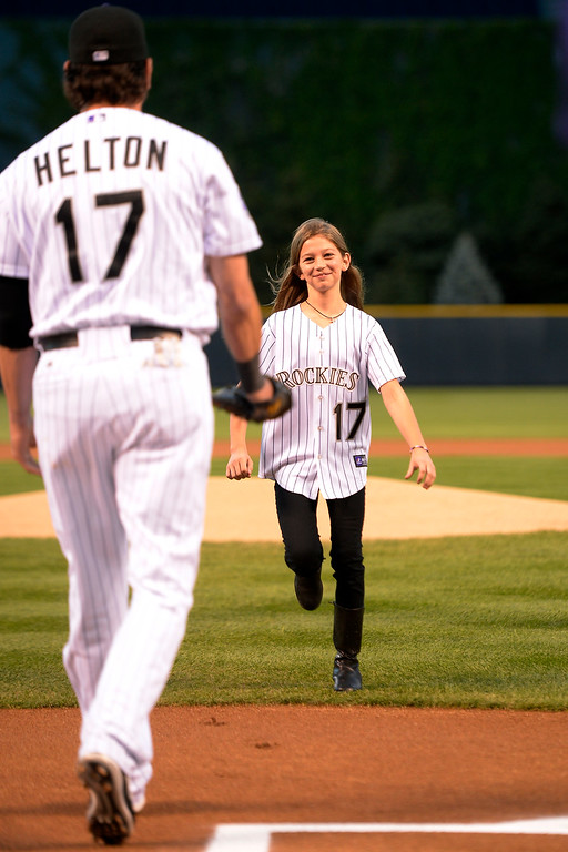 . Todd Helton awaits a hug from his daughter Tierney Faith before the start of action in Denver. The Colorado Rockies hosted the Boston Red Sox and said farewell to longtime first baseman Todd Helton, who recently announced his retirement following this season. (Photo by John Leyba/The Denver Post)