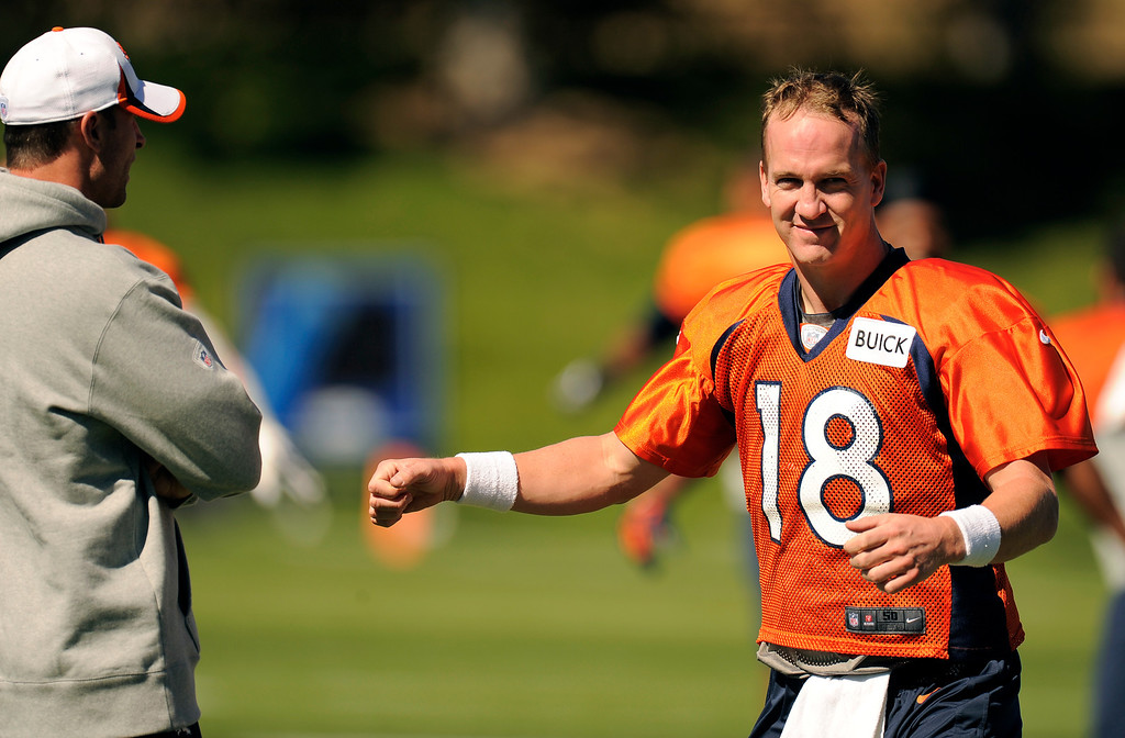 . Quarterback Peyton Manning (18) of the Denver Broncos stretches before practice September 25, 2013 at Dove Valley. (Photo by John Leyba/The Denver Post)