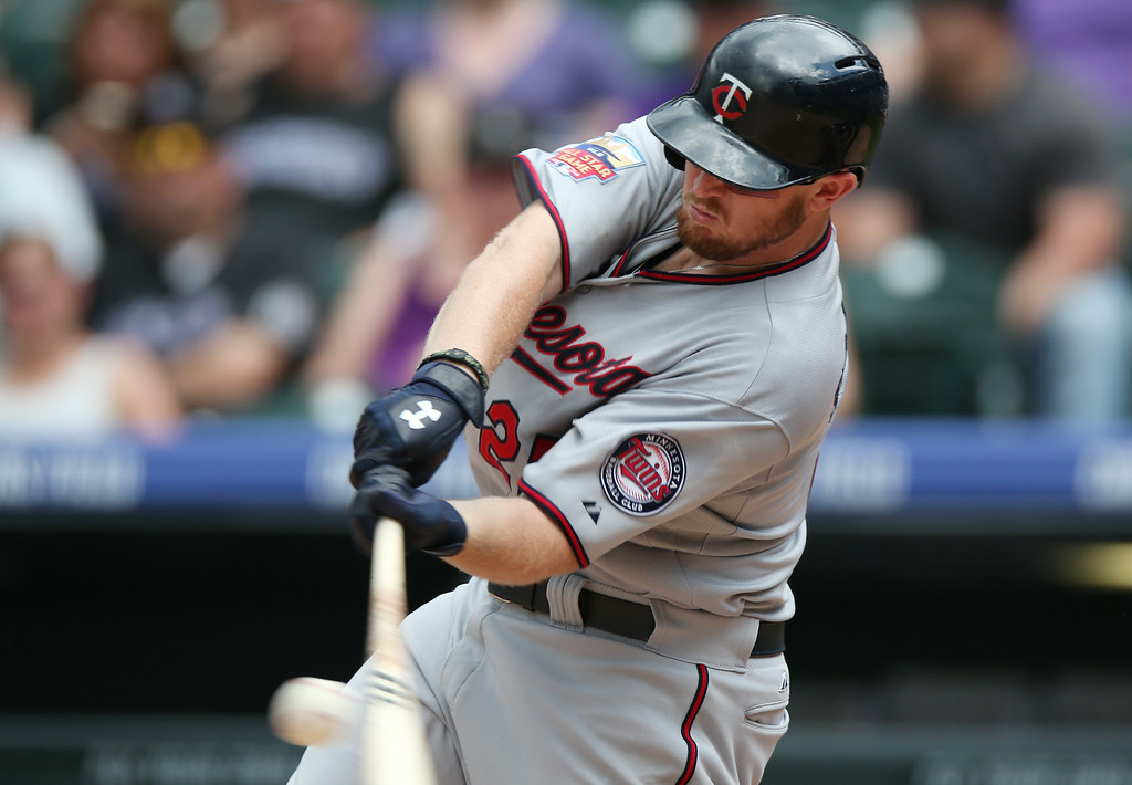 . Minnesota Twins\' Chris Parmelee fouls off a pitch against the Colorado Rockies to end the top of the eighth inning of the Twins\' 13-5 victory in an interleague baseball game in Denver on Sunday, July 13, 2014. (AP Photo/David Zalubowski)