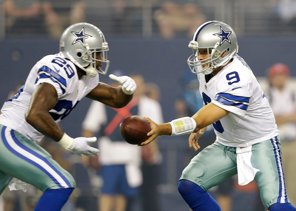 . Dallas Cowboys running back DeMarco Murray (29) takes the hand off from quarterback Tony Romo, right, in the first half of an NFL football game against the Washington Redskins, Sunday, Oct. 13, 2013, in Arlington, Texas. (AP Photo/LM Otero)