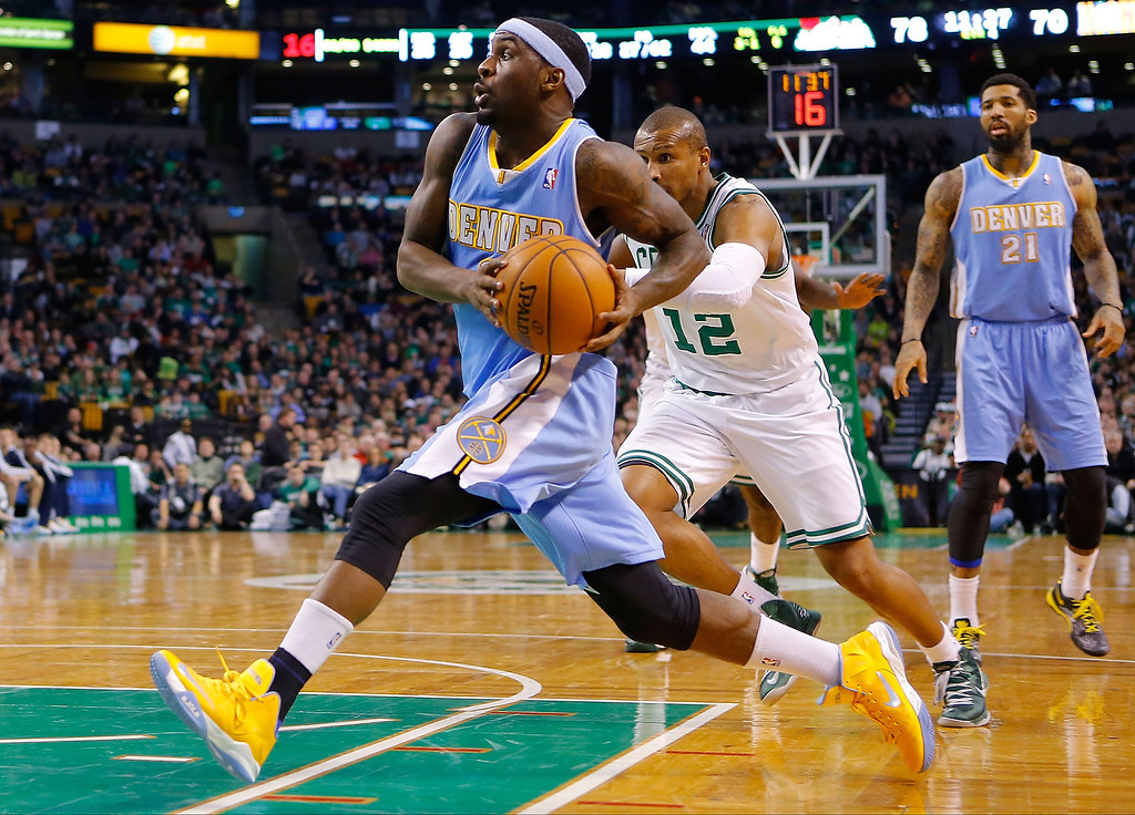. BOSTON, MA - FEBRUARY 10: Ty Lawson #3 of the Denver Nuggets drives to the basket against the Boston Celtics during the game on February 10, 2013 at TD Garden in Boston, Massachusetts.  (Photo by Jared Wickerham/Getty Images)