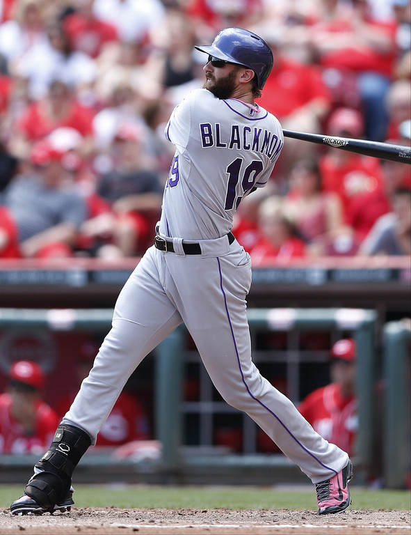 . Charlie Blackmon #19 of the Colorado Rockies hits a home run in the fourth inning of the game against the Cincinnati Reds at Great American Ball Park on May 11, 2014 in Cincinnati, Ohio. (Photo by Joe Robbins/Getty Images)