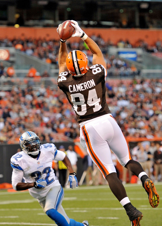 . Cleveland Browns tight end Jordan Cameron (84) catches a 10-yard touchdown pass against Detroit Lions strong safety Don Carey in the first quarter of a preseason NFL football game, Thursday, Aug. 15, 2013, in Cleveland. (AP Photo/David Richard)