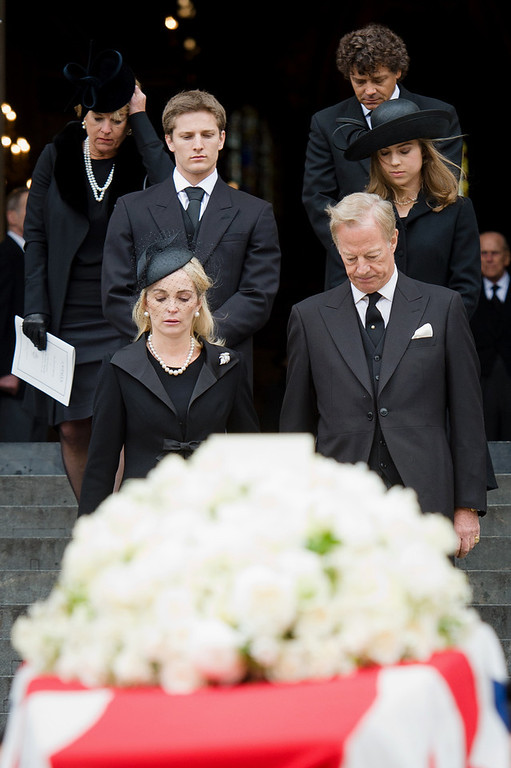 . The family of British former prime minister Margaret Thatcher follows her coffin as the Bearer Party made up of personnel from the three branches of the military carry it out of St Paul\'s Cathedral at the end of her ceremonial funeral in central London on April 17, 2013. The funeral of Margaret Thatcher took place on April 17, with Queen Elizabeth II leading mourners from around the world in bidding farewell to one of Britain\'s most influential and divisive prime ministers.  LEON NEAL/AFP/Getty Images