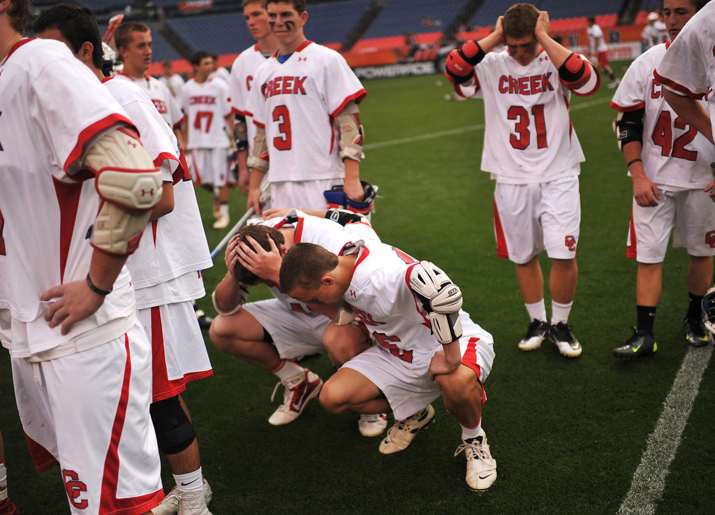 . DENVER, CO. - MAY 18 : Cherry Creek High School players show emotion after losing 5A Boy\'s Lacrosse Championship game against Arapahoe High School at Sports Authority Field at Mile High Stadium. Denver, Colorado. May 18, 2013. Arapahoe won 10-7. (Photo By Hyoung Chang/The Denver Post)