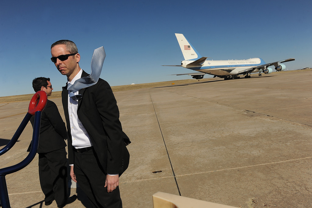 . AURORA, CO- APRIL 3: A member of the advanced security team for President Barack Obama gets blasted by the large gusts generated by as Air Force One as it gets ready for take-off at Buckley Air Force Base in Aurora, CO  on April 3, 2013.  The president traveled to Colorado to meet with local law enforcement officials and community leaders to discuss the new gun control measures that the state has put in place including loopholes in the back round check system. (Photo By Helen H. Richardson/ The Denver Post) (Photo By Helen H. Richardson/ The Denver Post)