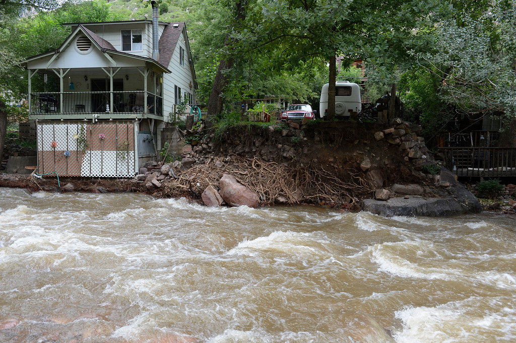 . ELDORADO SPRINGS, CO - SEPTEMBER 18: A home very close to the edge of a still raging South Boulder Creek in Eldorado Springs Colorado Wednesday afternoon, September 18, 2013. (Photo By Andy Cross/The Denver Post)
