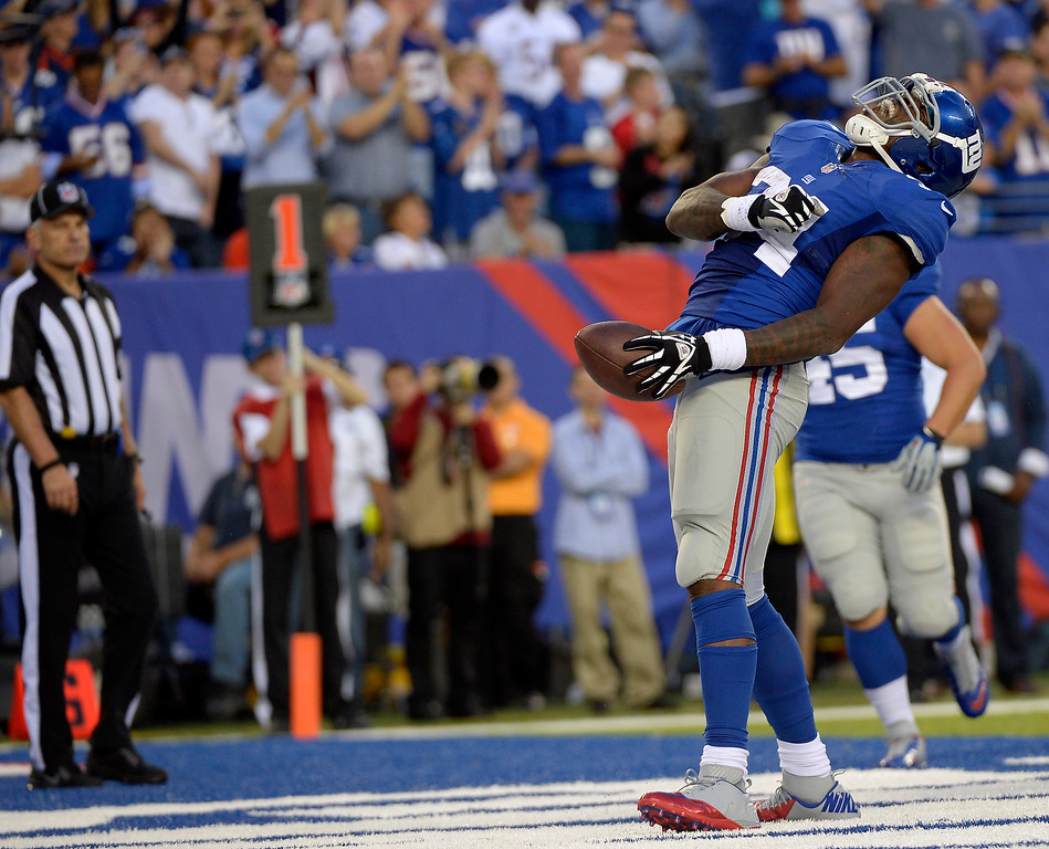 . New York Giants running back Brandon Jacobs (34) screams out after scoring a touchdown during the third quarter September 15, 2013 MetLife Stadium. (Photo by John Leyba/The Denver Post)