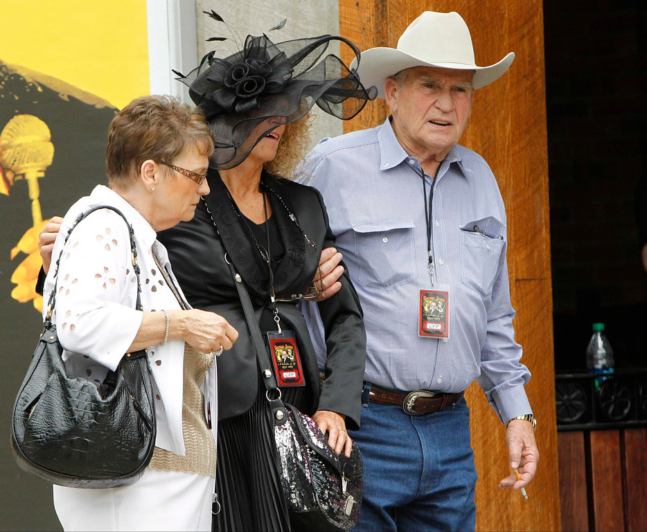 . Mourners leave a public memorial service for country music legend George Jones at the Grand Ole Opry House in Nashville, Tennessee, May 2, 2013. REUTERS/Harrison McClary