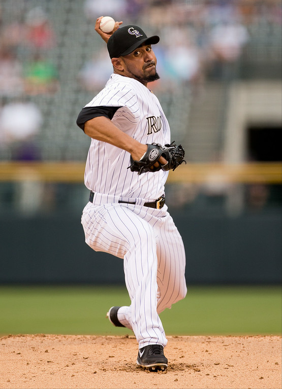 . Starting pitcher Franklin Morales #56 of the Colorado Rockies delivers to home plate during the first inning against the Los Angeles Dodgers at Coors Field on July 3, 2014 in Denver, Colorado.  (Photo by Justin Edmonds/Getty Images)