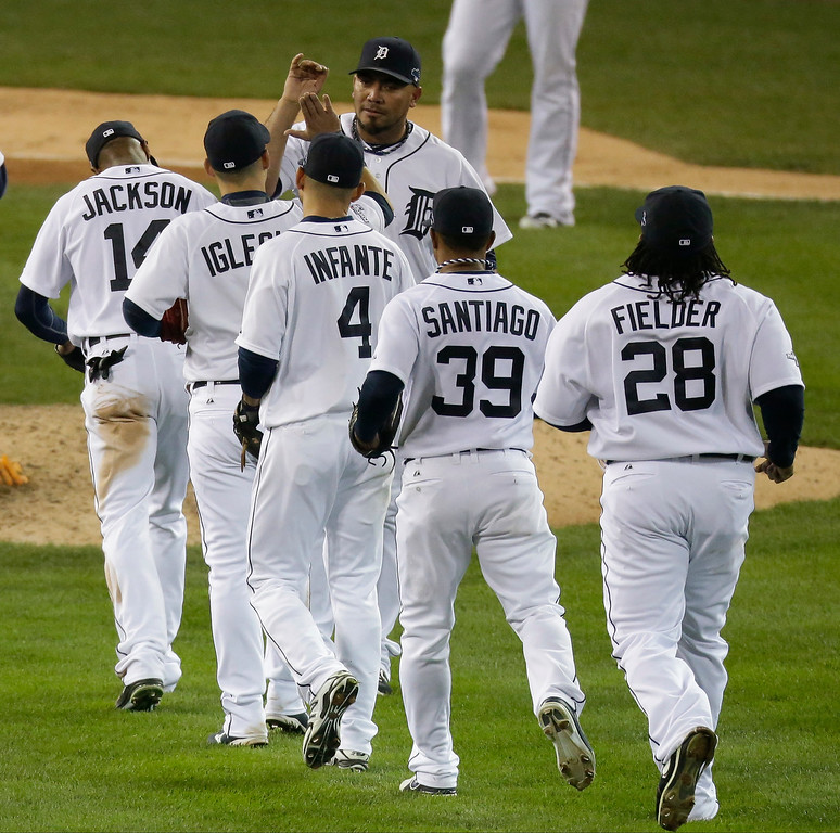 . Detroit Tigers\' Joaquin Benoit greets teammates after Game 4 of the American League baseball championship series against the Boston Red Sox Wednesday, Oct. 16, 2013, in Detroit. The Tigers won 7-3. (AP Photo/Charlie Riedel)