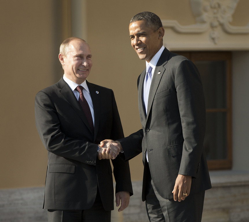 . Russias President Vladimir Putin (L) welcomes US President Barack Obama at the start of the G20 summit on September 5, 2013 in Saint Petersburg. Russia hosts the G20 summit hoping to push forward an agenda to stimulate growth but with world leaders distracted by divisions on the prospect of US-led military action in Syria. AFP PHOTO/POOL/Pablo Martinez MONSIVAIS/AFP/Getty Images